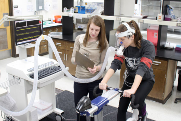 female researchers testing equipment