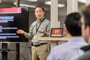 Glenn Liu, associate professor at the UW School of Medicine and Public Health, presents his cancer bone imaging project developed in conduction with Robert Jeraj, associate professor of medical physics, to a group of fellow entrepreneurs at a Discovery to Product (D2P) workshop at the University of Wisconsin-Madison on Sept. 30, 2014. (Photo by Bryce Richter / UW-Madison)