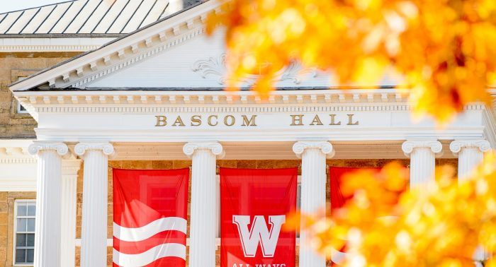 Framed by the golden leaves of fall, W campaign banners adorn the columns of Bascom Hall at the University of Wisconsin-Madison on Nov. 4, 2016. (Photo by Bryce Richter / UW-Madison)