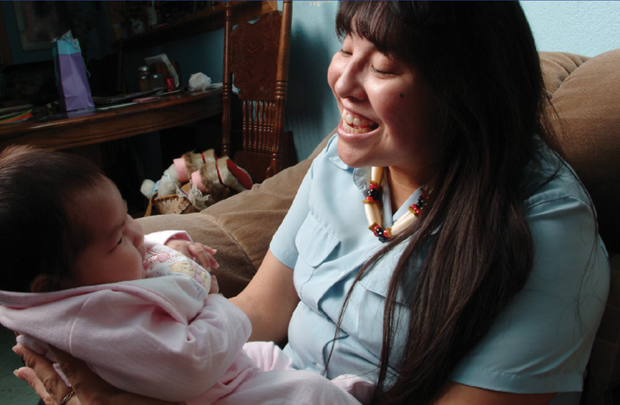Woman holding baby. Credit: Healthy Native Babies Toolkit/NICCHD, US Dept of Health and Human Services