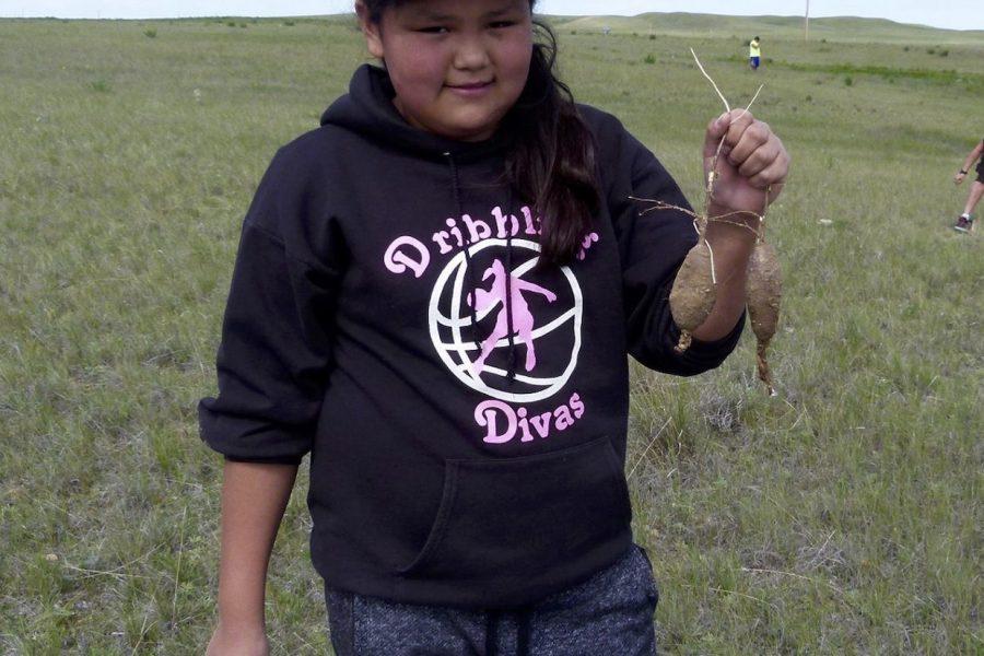 Girl with wild turnips