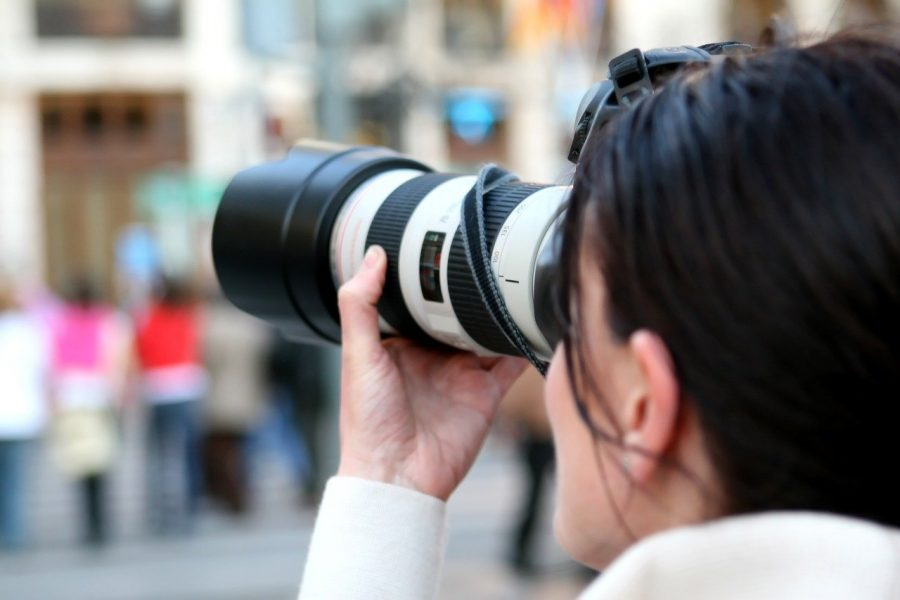 Woman with camera. Credit: Image by Shutterbug75 from Pixabay