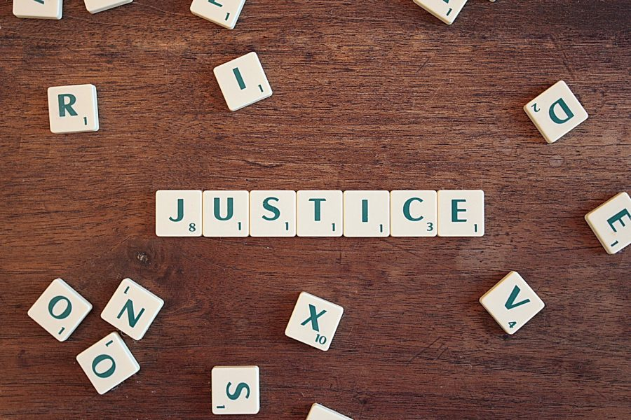 Scrabble tiles spell out JUSTICE. Credit: Image by CQF-avocat from Pixabay